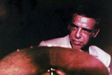 Buddy Rich playing the drums.
