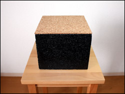Black-painted concrete with a thin layer of cork at the top.