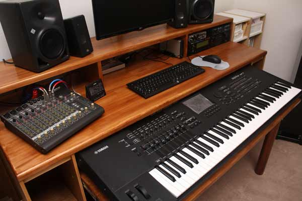 Close up of the desk surface, with music equipment on.