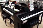 Two digital pianos in a shop.