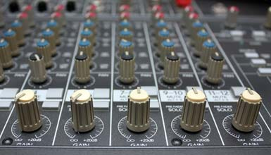 Close-up of a mixer, showing its many potentiometers.
