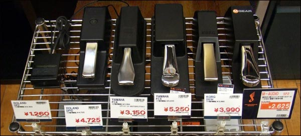 A display of six sustain pedals.