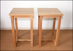 Two sturdy wooden plant stands, which make good speaker stands.
