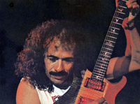 Carlos Santana playing his guitar.