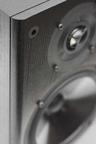 Close up of the front baffle of the TB2, showing the rounded vertical edge.